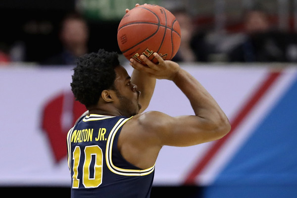 Derrick Walton Jr. shooting a free throw vs. Wisconsin in the Big Ten Championship. Photo Credit: Rob Carr- Getty Images