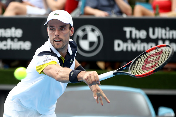 Roberto Bautista Agut returns a serve during the final | Photo: Phil Walter/Getty Images AsiaPac
