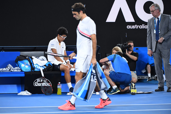 Federer walks past a disconsolate Chung (Quinn Rooney/Getty Images AsiaPac)