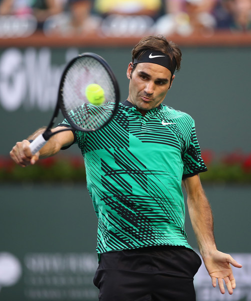 Roger Federer hits a backhand during his straight-sets victory over Rafael Nadal in the fourth round of the 2017 BNP Paribas Open. | Photo: Clive Brunskill/Getty Images