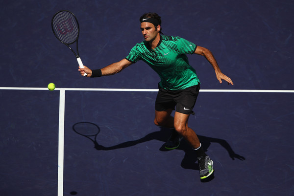 Roger Federer hits a forehand volley during his straight-sets victory over Jack Sock in the semifinals of the 2017 BNP Paribas Open. | Photo: Clive Brunskill/Getty Images