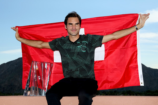 Federer celebrates his success in the Californian desert (Photo: Matthew Stockman/Getty Images North America)