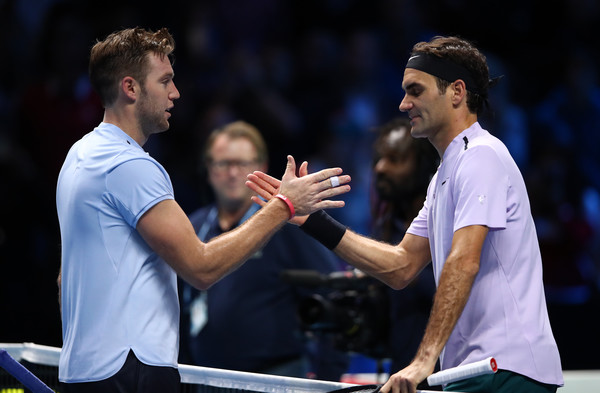 Federer and Sock meet at the net for a handshake | Photo: Clive Brunskill/Getty Images Europe