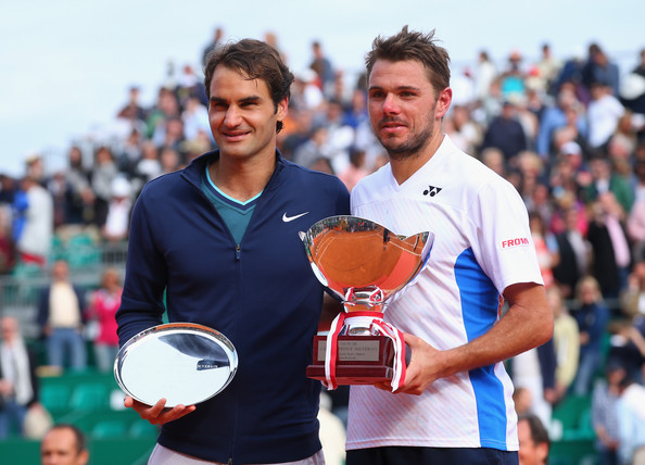 Roger Federer and Stan Wawrinka pose with their trophies after meeting in the final of the 2014 Monte-Carlo Rolex Masters. | Photo: Julian Finney/Getty Images