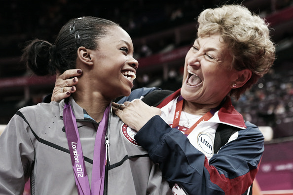 Marta Karolyi celebrating a gold medal with Gabby Douglas in London. Photo Credit: Ronald Martinez of Getty Images