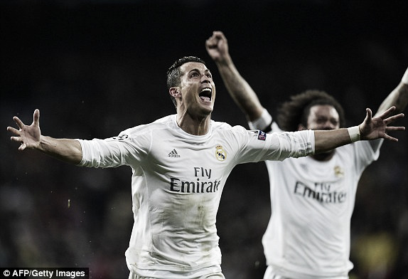 Above: Cristiano Ronaldo celebrates his third goal in Real Madrid's 3-0 win over Wolfsburg| Getty Images