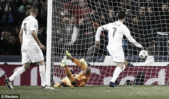 Above: Cristiano Ronaldo strikes home his first goal of three during Real Madrid's 3-0 win over Wolfsburg   Reuters