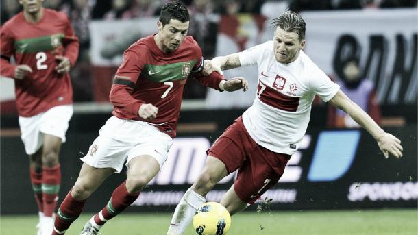 Above: Cristiano Ronaldo battling with Damien Perquis in Poland's 0-0 draw with Portugal back in 2012 | Photo: fifa.com