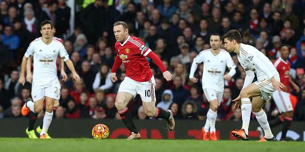 Rooney runs with the ball - Swansea in January | Photo: Matthew Peters/Man Utd