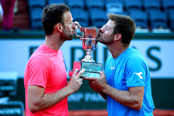 Photo Source: Clive Brunskill/Getty Images Europe-Ryan Harrison and Michael Venus kissed the Roland Garros championship trophy.