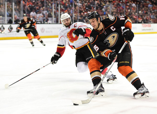 Ryan Getzlaf #15 of the Anaheim Ducks breaks in past Mark Giordano #5 of the Calgary Flames for a backhand during the third period of an 8-3 Ducks win at Honda Center on March 30, 2016 in Anaheim, California. (March 29, 2016 - Source: Harry How/Getty Images North America)