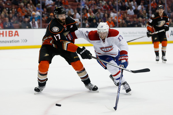 Torrey Mitchell #17 of the Montreal Canadiens and Ryan Kesler #17 of the Anaheim Ducks battle for a loose puck during the third period of a game at Honda Center on March 2, 2016 in Anaheim, California. (March 1, 2016 - Source: Sean M. Haffey/Getty Images North America)
