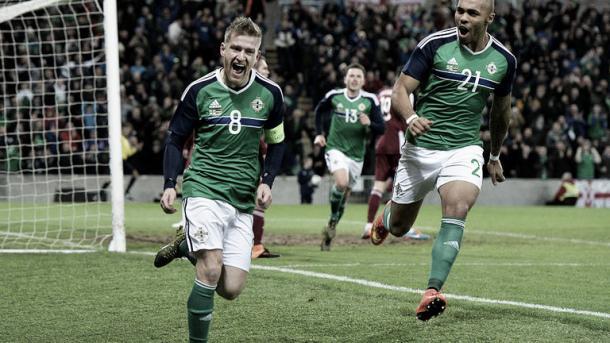 Steve Davis wheels away in celebration after scoring against Latvia. | Image source: Sky Sports