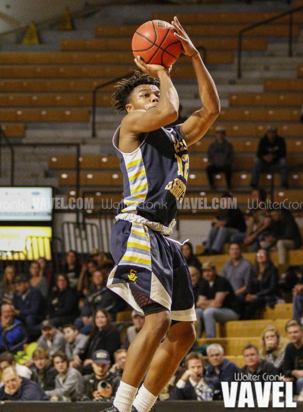PJ Austin (12) takes the open three point shot. Photo: Walter Cronk