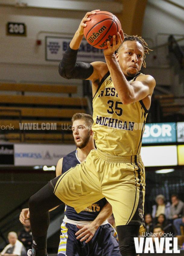 Brandon Johnson (35) grabs the rebound. Photo: Walter Cronk