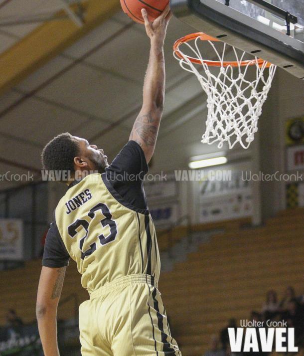 Reggie Jones (23) go's in for the open lay up. Photo: Walter Cronk