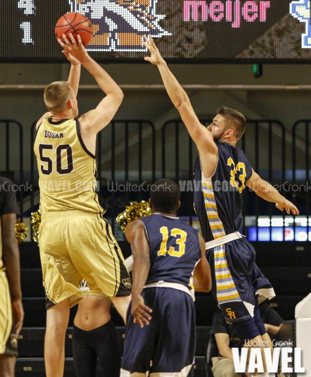 Trevor Holston (33) cant get to Seth Dugan (50) in time as he's taking the short jump shot. Photo: Walter Cronk