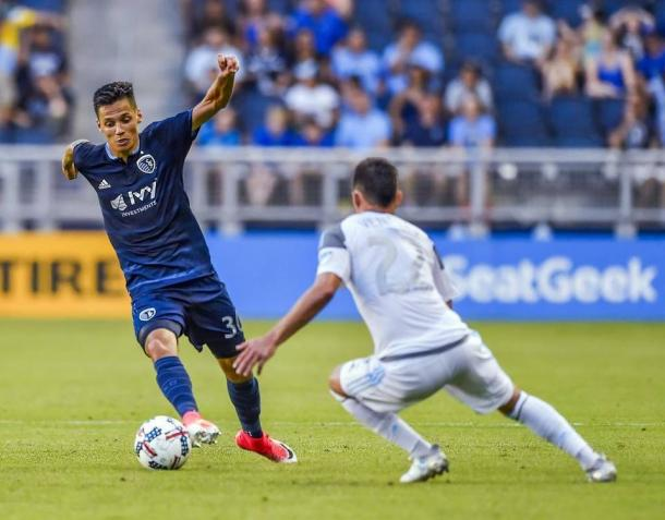 Kevin Venegas plays defense against Sporting Kansas City. (Allison Long/Kansas City Star)