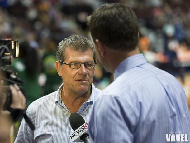 University of Connecticut women's basketball head coach Geno Auriemma speaks with a local news reporter prior to the WNBA game between the Connecticut Sun and Seattle Storm at Mohegan Sun Arena in Uncasville, CT. (Photo by Stephen Furst/VAVEL USA)