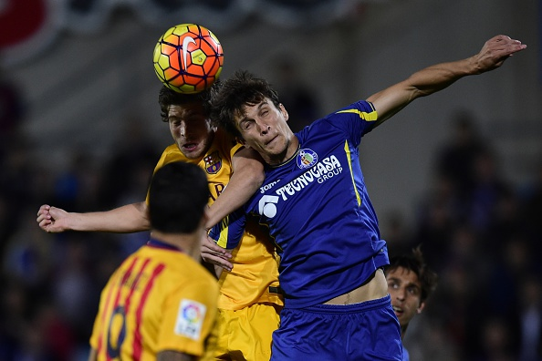 Vergini battles for the ball against Barcelona. | Image credit: JAVIER SORIANO/AFP/Getty Images