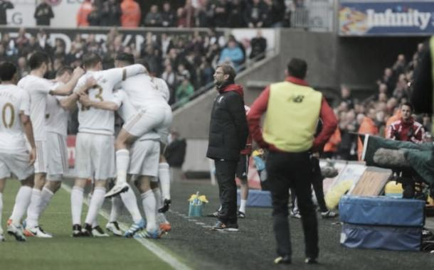 The Swansea players celebrating Jack Cork's goal on Sunday against Liverpool at Liberty Stadium. Photo provided by Getty Images.