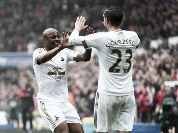 Gylfi Sigurdsson (Right) and Andre Ayew (Right) celebrating Ayew's first goal of the match on Sunday against Liverpool at Liberty Stadium. Photo provided by Getty Images.