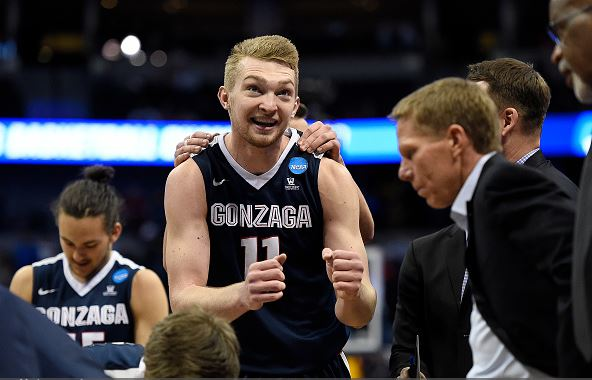 Domantas Sabonis (11) of the Gonzaga Bulldogs dances in a huddle in the waning minutes against the Utah Utes during the second half of Gonzaga's 82-59 second round NCAA Tournament game win on Saturday, March 19, 2016. (Photo by AAron Ontiveroz/The Denver Post via Getty Images
