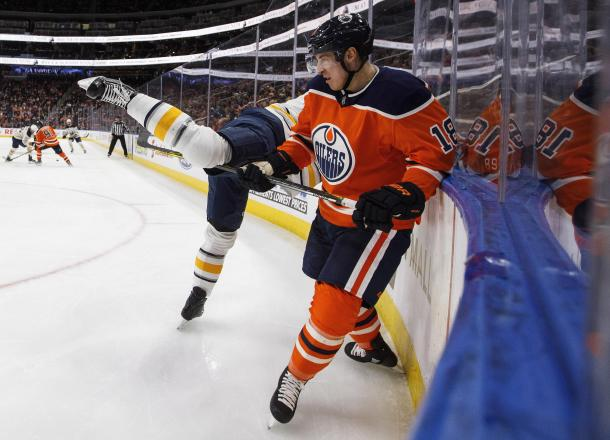 Edmonton Oilers Ryan Strome puts the hurt on tough guy Jordan Nolan, but Sabres won this game. (Photo: Boston Herald)