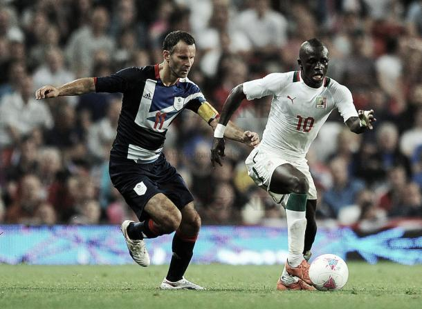 Mane battles for possession with Great Britain's Ryan Giggs in 2012 (image:propaganda.photoshelter.com)