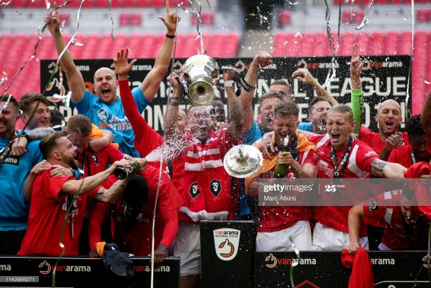 LONDON, ENGLAND - MAY 11: Salford City players celebrate promotion during the Vanarama National League Play Off Final between AFC Fylde and Salford City at Wembley Stadium on May 11, 2019 in London, England. (Photo by Marc Atkins/Getty Images)