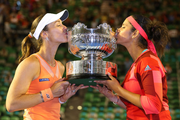 Hingis (left) and Mirza kiss their Australian Open trophy in January. Photo: Scott Barbour/Getty Images