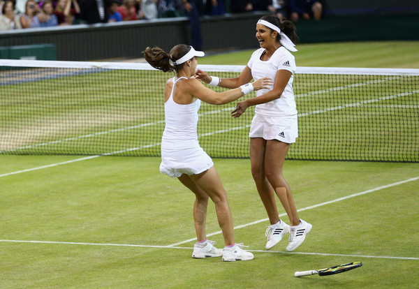 Mirza (right) and Hingis celebrate their Wimbledon win last July. Photo: Clive Brunskill/Getty Images