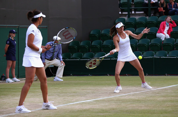 Hingis (right) hits a forehand as Mirza watches last year at Wimbledon. Photo: Carl Court/Getty Images