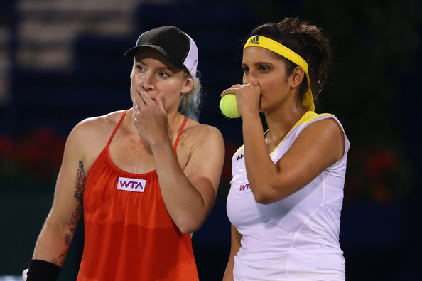 Mattek-Sands and Mirza discuss tactics during a match in 2013 | Photo: Julian Finney/Getty Images Europe