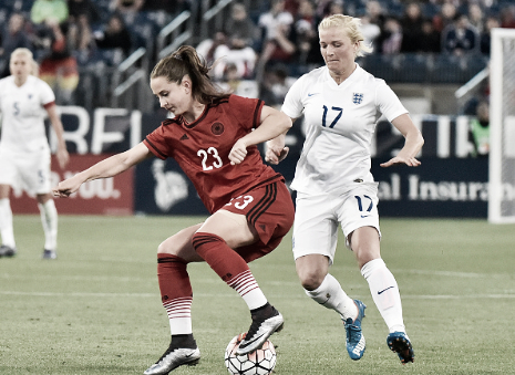 Sara Dabritz maneuvers past England's Katie Chapman in the 2016 SheBelieves Cup (Photo: Getty/Frederick Beeton)