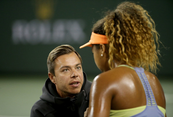 Sascha Bajin coaches Naomi Osaka during one of the changeovers of Osaka's match with American Sachia Vickery at the 2018 BNP Paribas Open—a match she would win en route to capturing her first-ever professional title in Indian Wells. | Photo: Jeff Gross/Getty Images