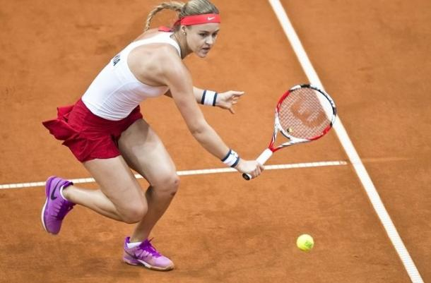 Anna-Karolina Schmiedlova hits a volley during the second rubber. Photo: Roman Benicky/Fed Cup