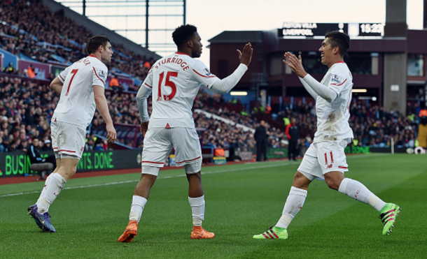 Sturridge celebrates his opening goal with James Milner and Roberto Firmino. (Picture: Getty Images)