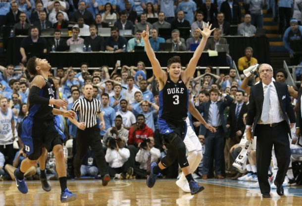 Grayson Allen and Derrick Thornton run off jubilated while Roy Williams looks on as Duke stuns Carolina in Chapel Hill. Streeter Lacka/Getty Images