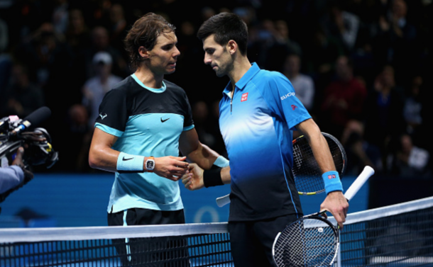 Novak Djokovic of Serbia shakes hands at the net after his straight sets victory against Rafael Nadal of Spain during the men's singles semi final match on day seven of the Barclays ATP World Tour Finals at O2 Arena on November 21, 2015 in London, England. (Photo by Clive Brunskill/Getty Images)