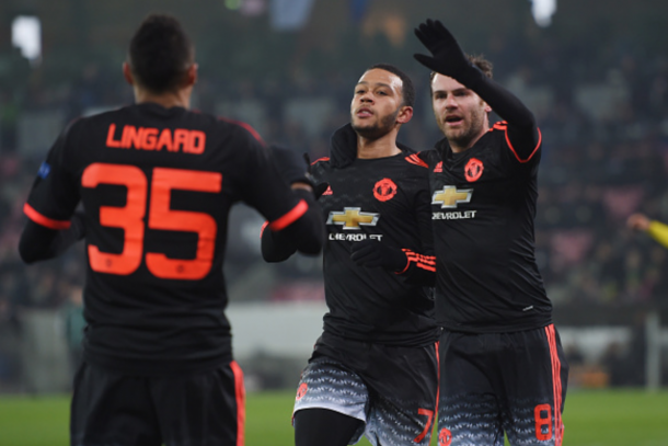 Lingard and Mata join Memphis as they celebrate the opener (Getty)