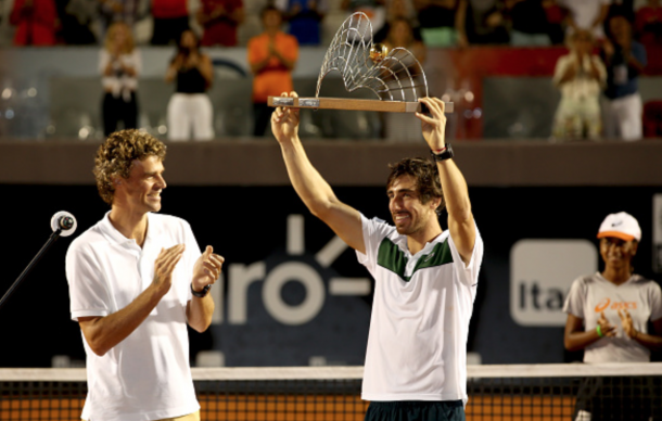 Gustavo Kuerten of Brazil watches as Pablo Cuevas of Uraguay celebrates his win over Guido Pella of Argentina during the final of the Rio Open at Jockey Club Brasileiro on February 21, 2016 in Rio de Janeiro, Brazil. (Photo by Matthew Stockman/Getty Images)