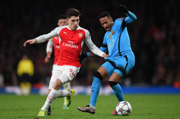 Héctor Bellerín tussles with Neymar. (Picture: Getty Images)