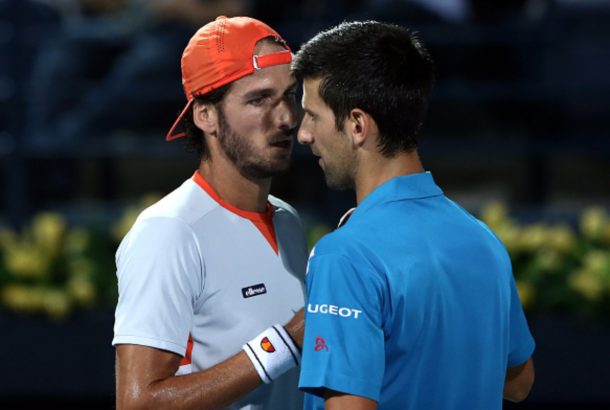 Novak Djokovic of Serbia shakes hands with Feliciano Lopez of Spain as he withdraws from his quarter final match on day six of the ATP Dubai Duty Free Tennis Championship at the Dubai Duty Free Stadium on February 25, 2016 in Dubai, United Arab Emirates. (Photo by Warren Little/Getty Images)