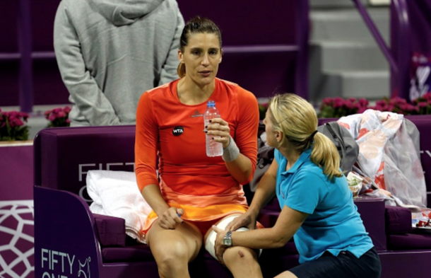 Andrea Petkovic of Germany drinks water during a match against Jelena Ostapenko of Latvia in the women's singles Qatar Open tennis tournament on February 26, 2016 at Khalifa International Tennis and Squash Complex in Doha. (Photo by Mohamed Farag/Anadolu Agency/Getty Images)