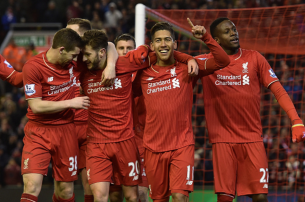 The Liverpool team after Firmino made it three. (Picture: Getty Images)