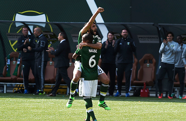 Darlington Nagbe celebrates Diego Valeri's first half goal. (Photo credit: Steve Dykes, Getty Images)