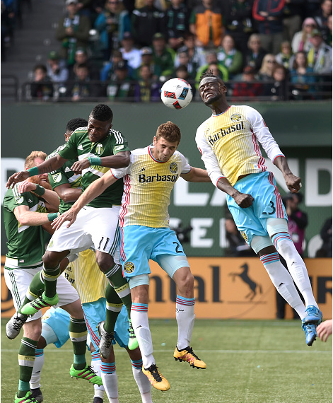 Kei Kamara, right, attempts a header on Portland's goal. (Photo credit: Steve Dykes, Getty Images)