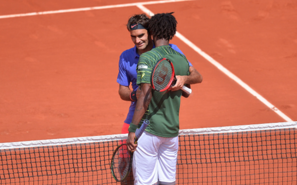 Roger Federer of Switzerland shakes hands with Gael Monfils of France after their men's singles fourth round match against on day nine of the French Open at Roland Garros on June 1, 2015 in Paris, France. (Photo by Aurelien Meunier/Getty Images)