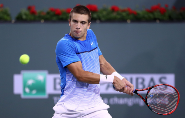 Borna Coric of Croatia plays a backhand in his match against Tomas Berdych of Czech Republic during day eight of the BNP Paribas Open at Indian Wells Tennis Garden on March 14, 2016 in Indian Wells, California. (Photo by Julian Finney/Getty Images)